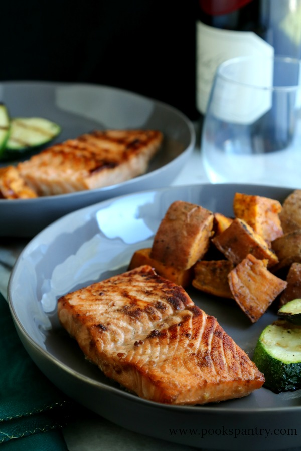 shallow bowl with bourbon salmon and vegetables