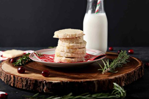 shortbread cookies on wooden platter with milk