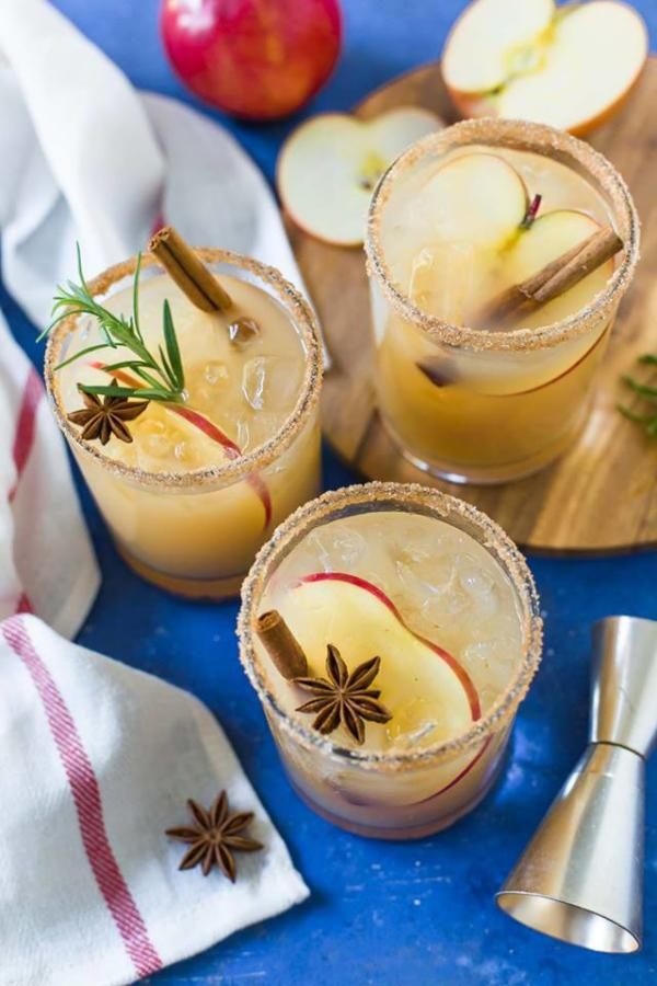apple cider margaritas on blue table with white towel