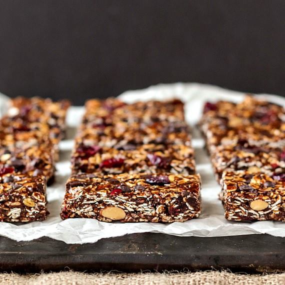 vegan granola bars on white parment on a black background