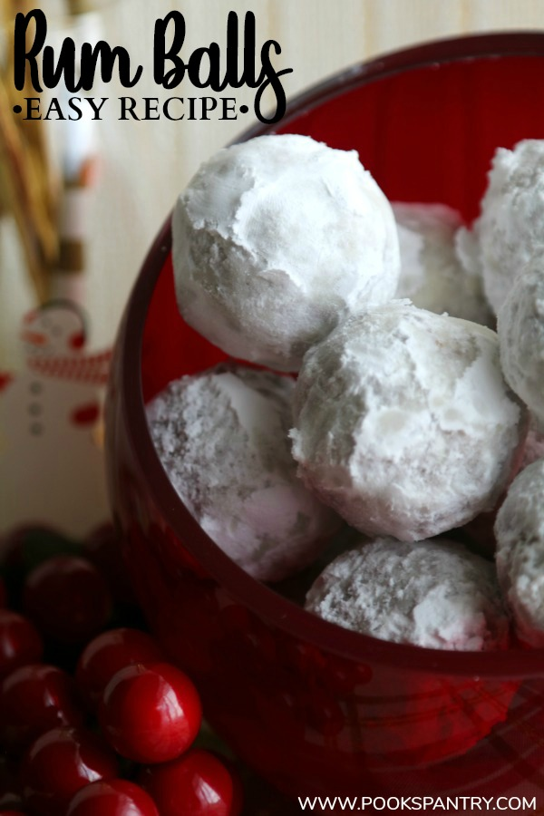 rum balls rolled in powdered sugar in red glass bowl