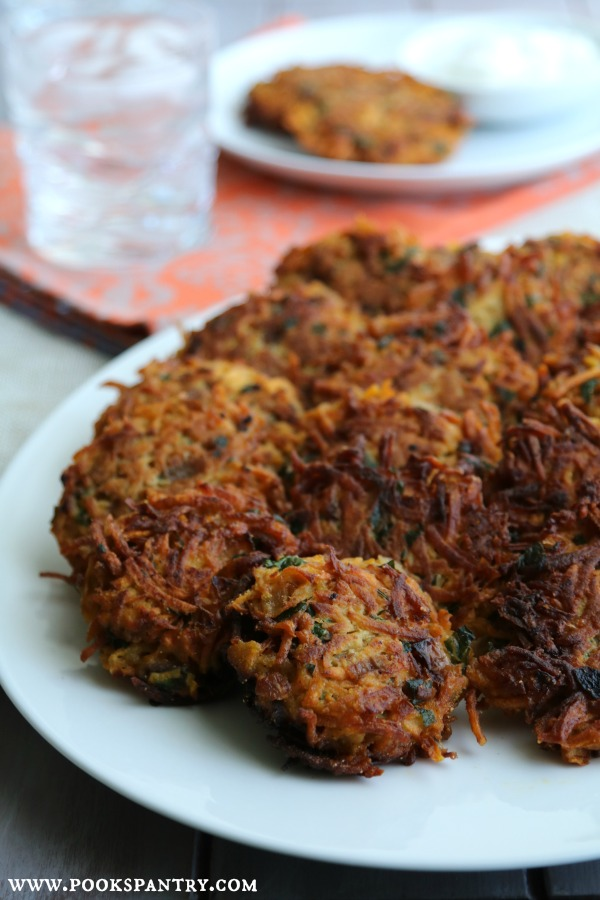 sweet potato cakes on white platter with orange napkin