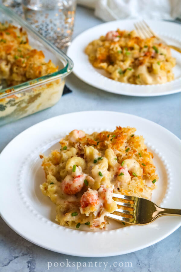 plate of langostino mac and cheese with gold fork