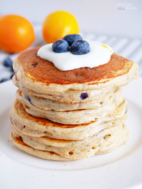 bluberry protein pancakes on white plate with blueberries on top