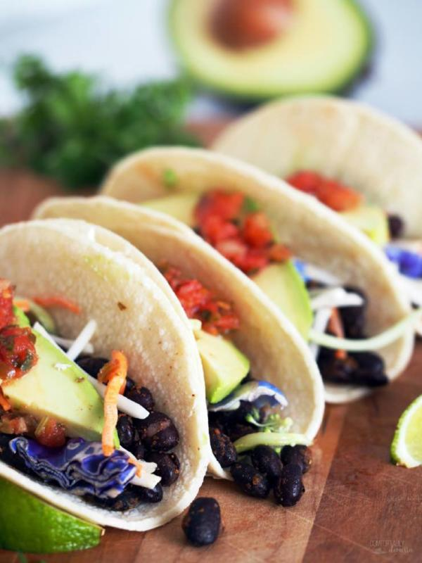black bean tacos on wooden board