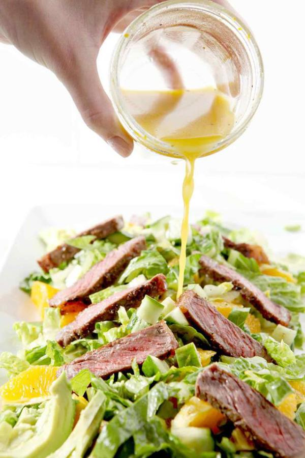 steak salad with hand pouring vinaigrette