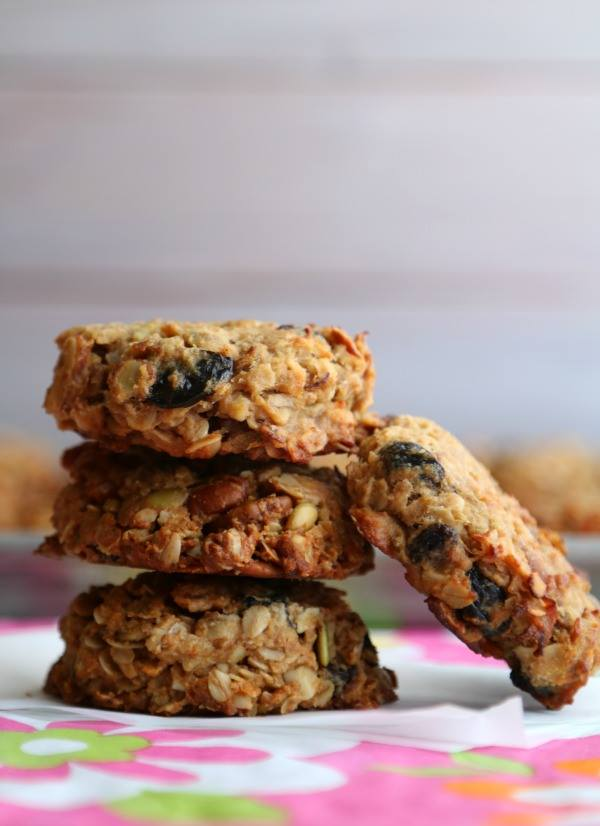 granola breakfast cookies stacked up on pink tablecloth