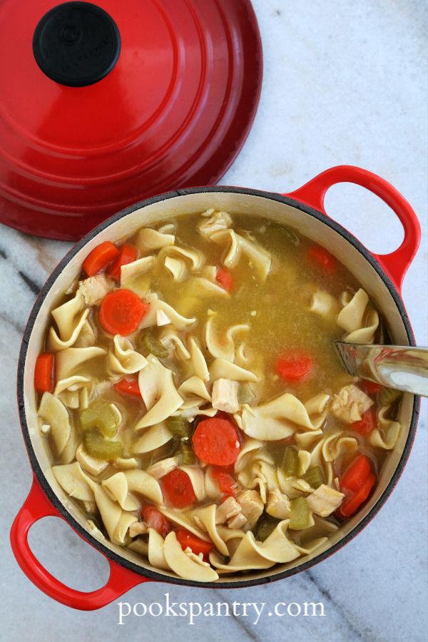 pot of soup with ladle
