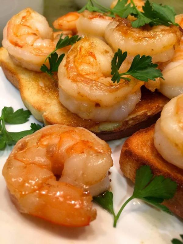 shrimp sandwich on white plate with parsley