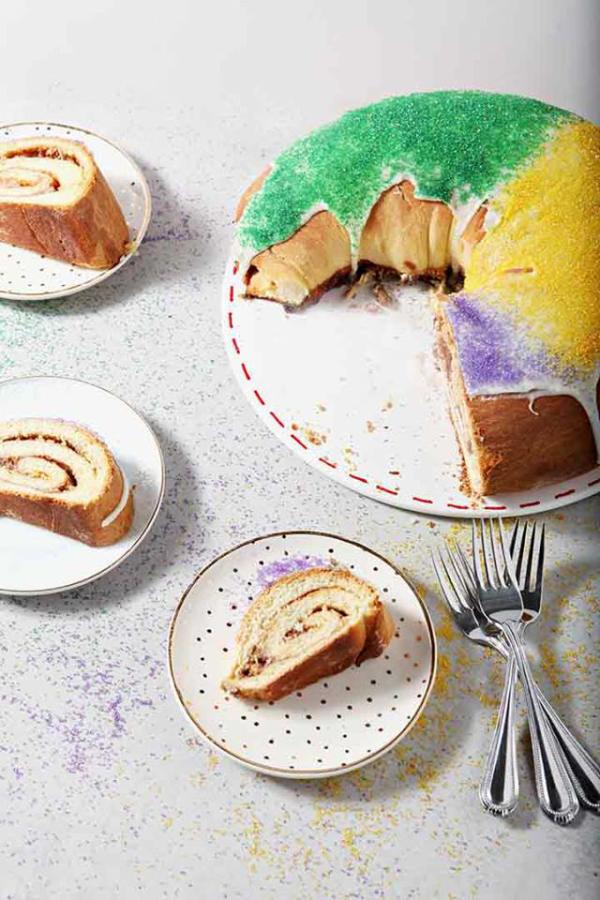 slices of king cake on plates with king cake