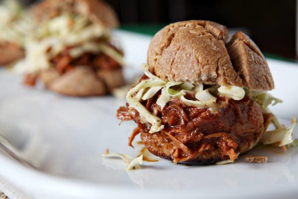 bbq chicken sandwiches with slaw on white plate