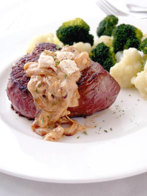 sirloin steaks with gravy on white plate