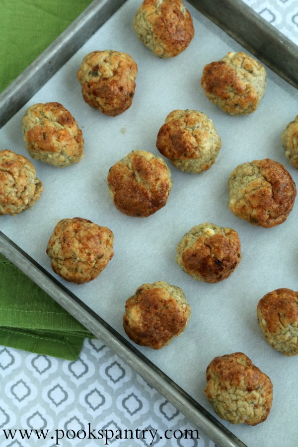 baked meatballs on sheet pan with green napkin