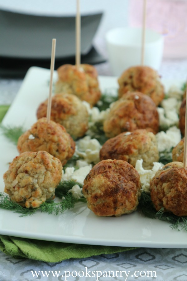mediterranean baked chicken meatballs on white platter