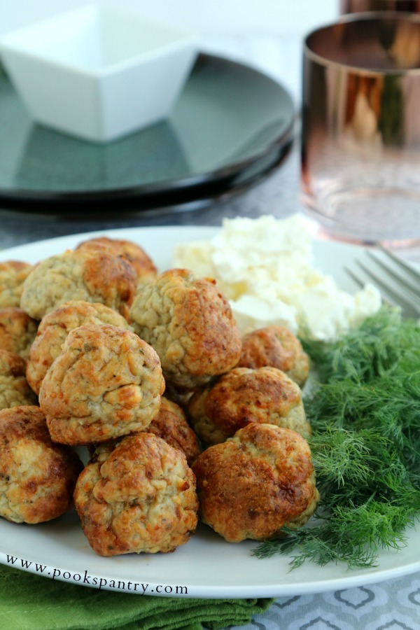 meatballs with feta and dill on white plate