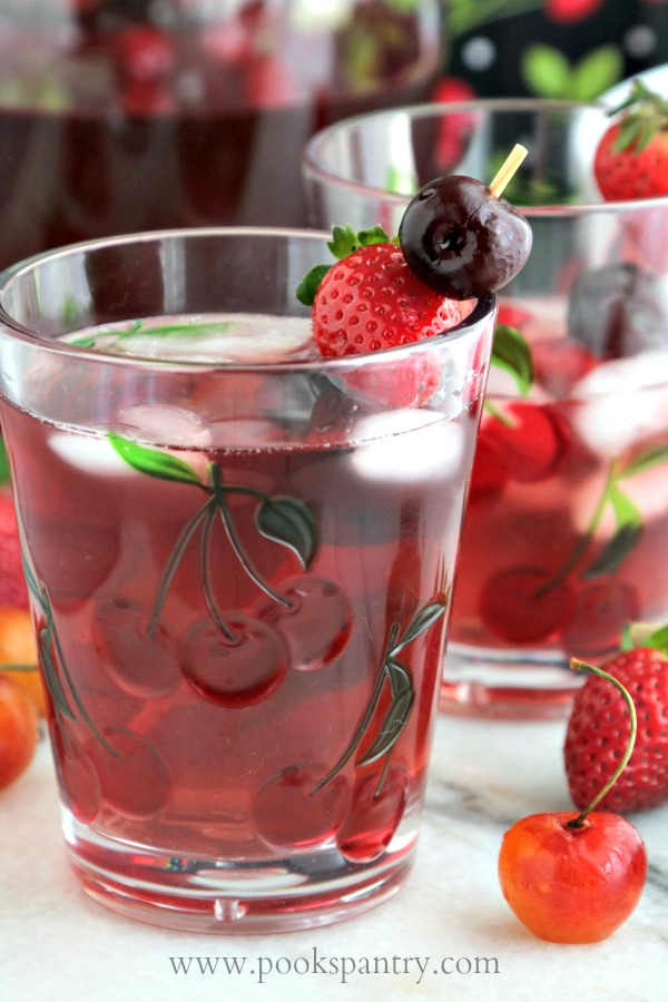 close up of white wine spritzer with fruit