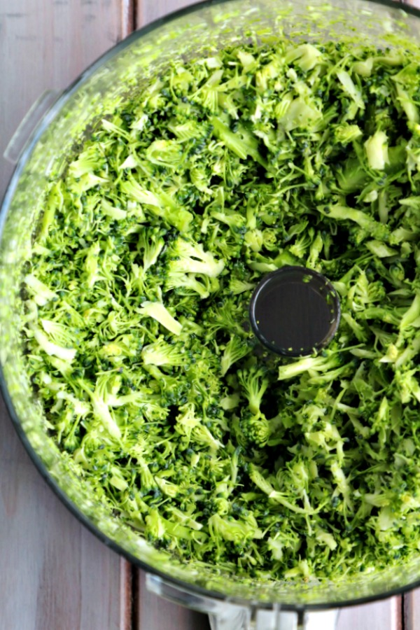 Grated broccoli in food processor.