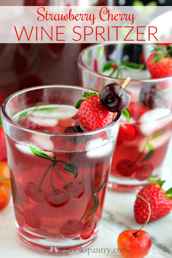 strawberry cherry wine spritzer in cherry glass with skewered fruit