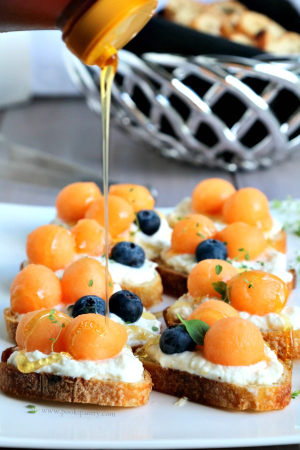 drizzling honey on the melon ricotta bruschetta