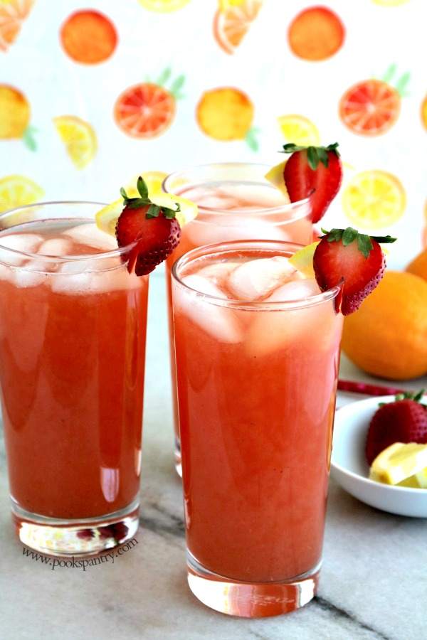 strawberry arnold palmers with citrus background