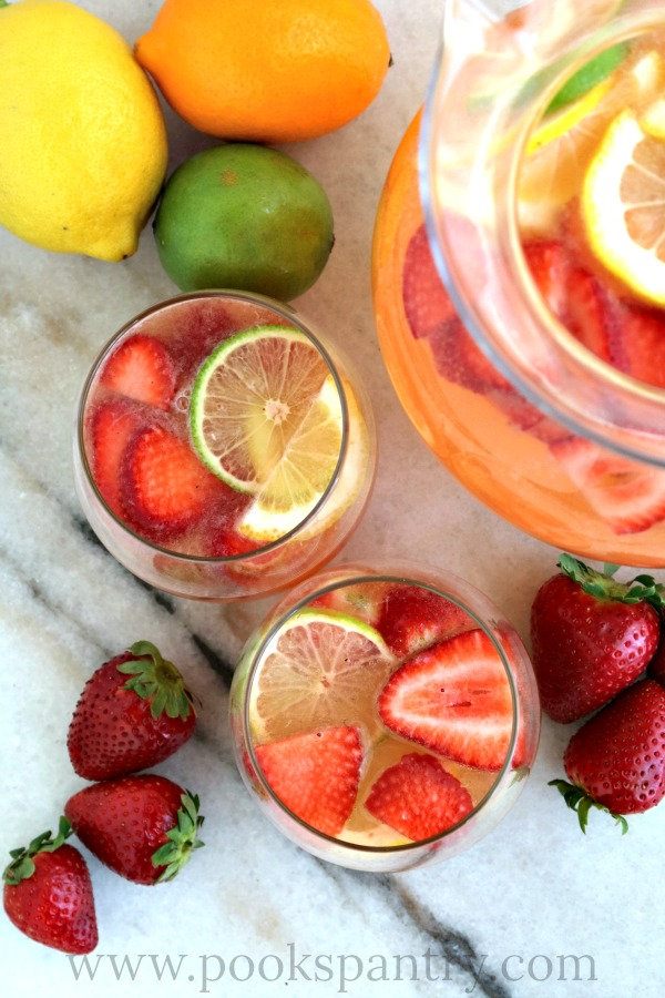 overhead photos of strawberry sangria on marble board