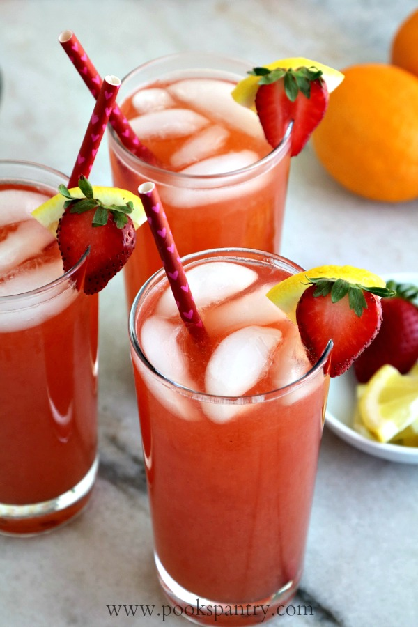 three glasses of strawberry lemonade tea with straws