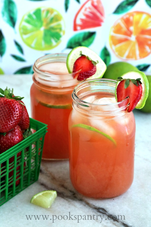 limeade with strawberries and a basket of strawberries