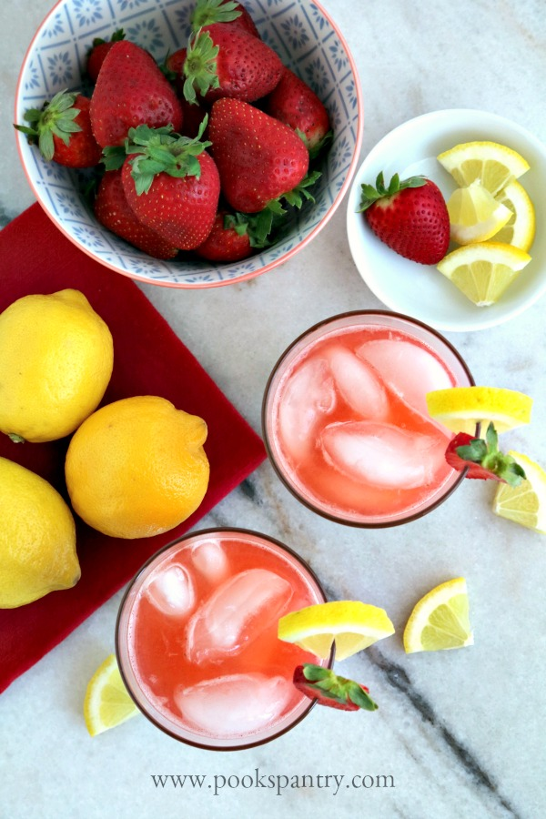 overhead view of drinks with lemons and strawberries