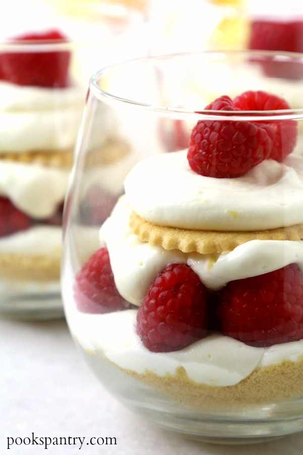 lraspberry lemon cheesecake parfaits in clear glasses