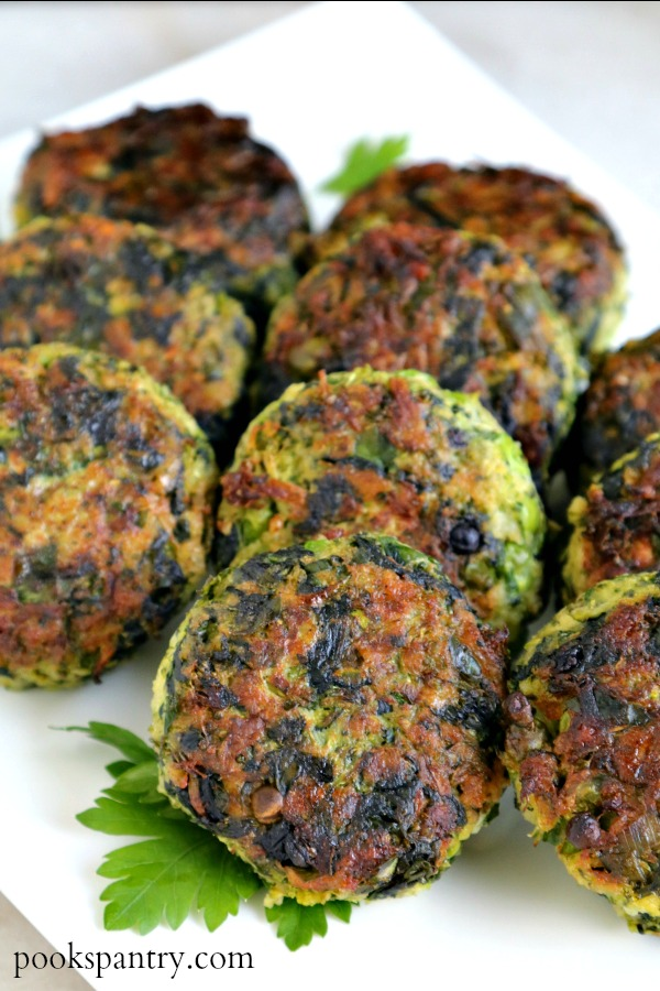 vegetable cakes on white platter with parsley