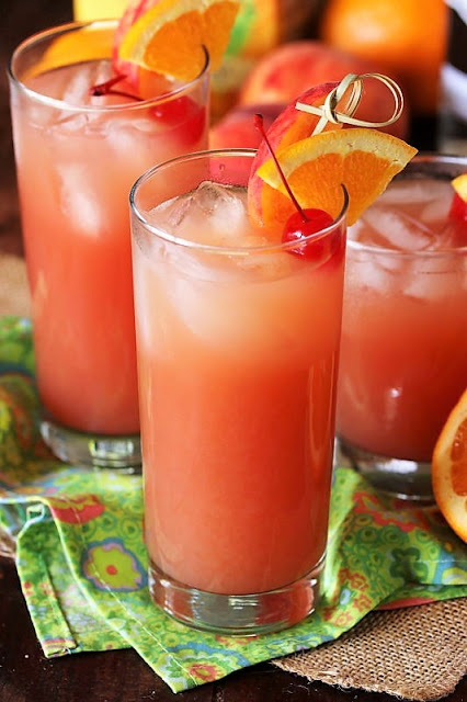 easy summer cocktails fruity drink with orange and cherry garnish