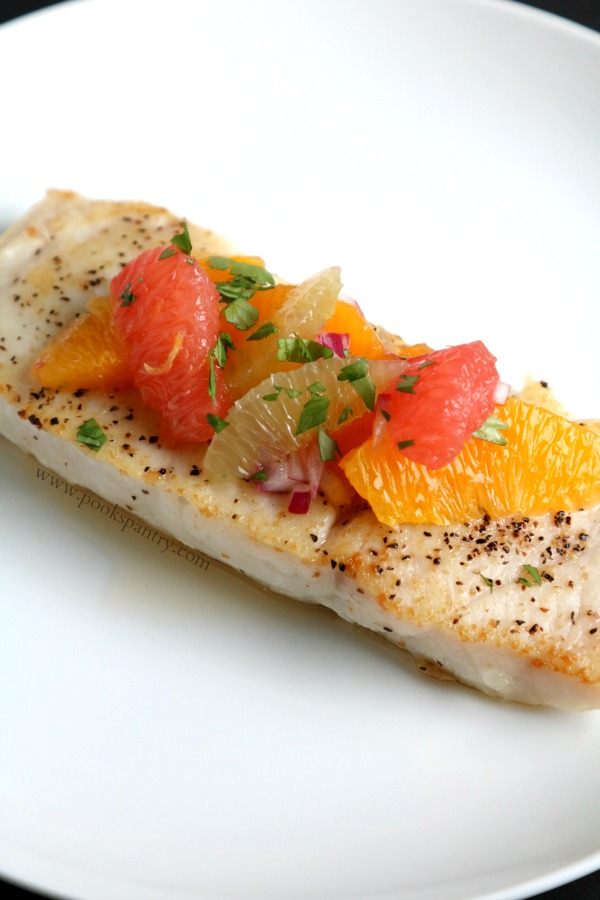 corvina with salsa on white plate