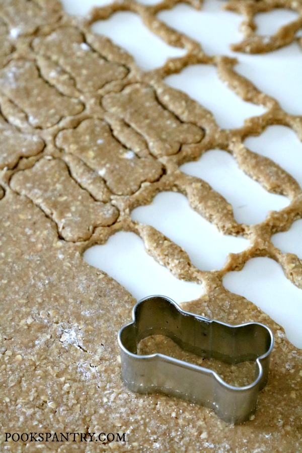 peanut butter banana dog treat dough with bone cookie cutter