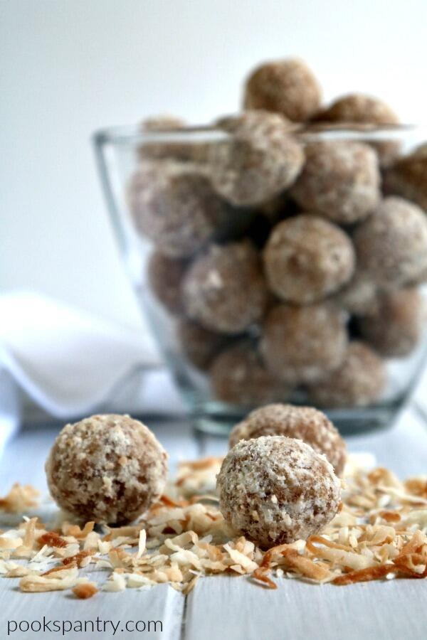 coconut rum balls on bed of toasted coconut