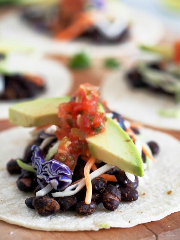 open black bean taco with avocado