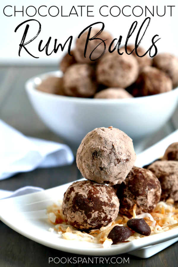 cocoa covered rum balls stacked on small white plate