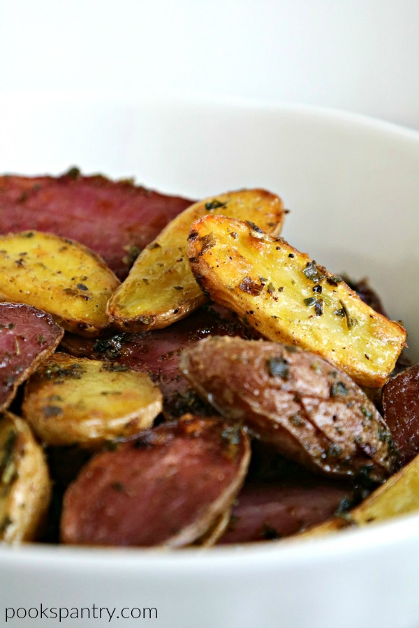 close up of baked fingerling potatoes in bowl