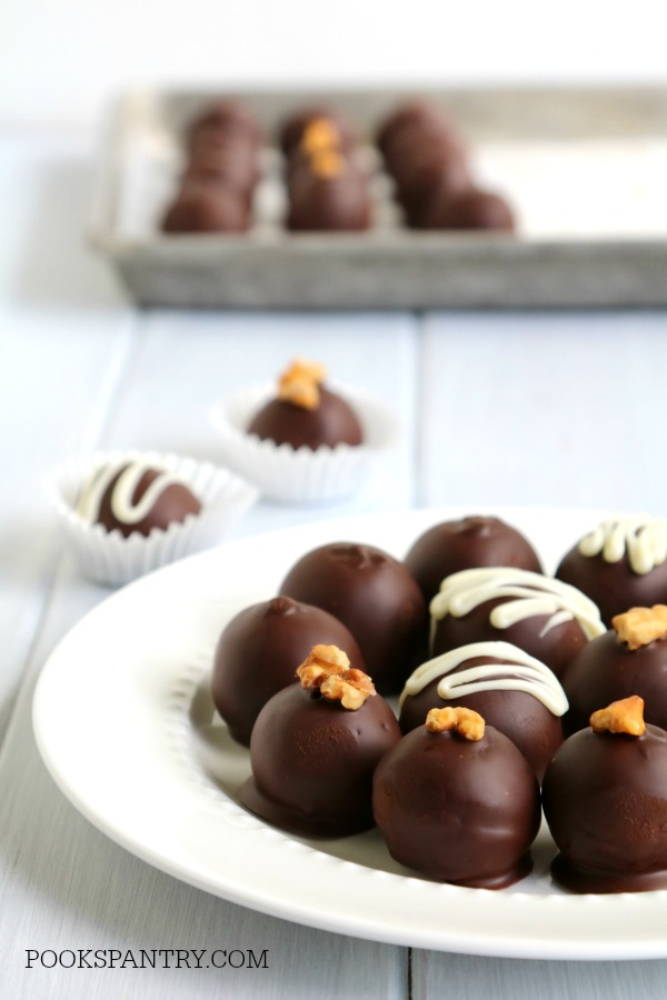 chocolate covered rum balls on white plate