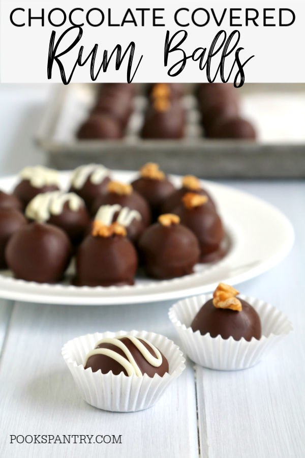 chocolate covered rum balls with white chocolate drizzle