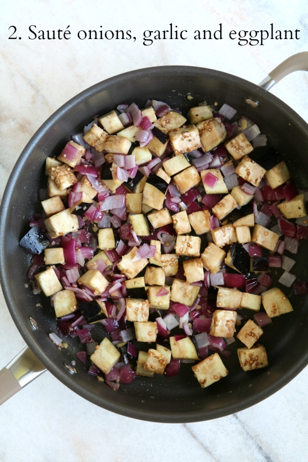 onions, garlic and eggplant in pan
