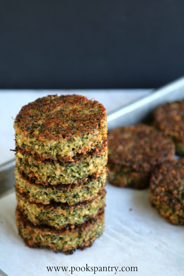 broccoli cakes stacked up on sheet pan