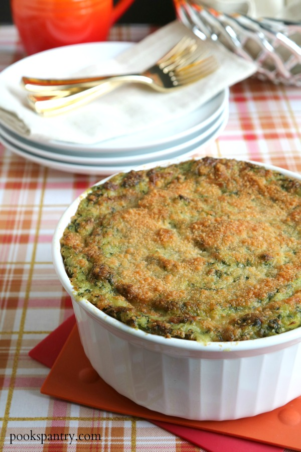 potato spinach casserole in white dish
