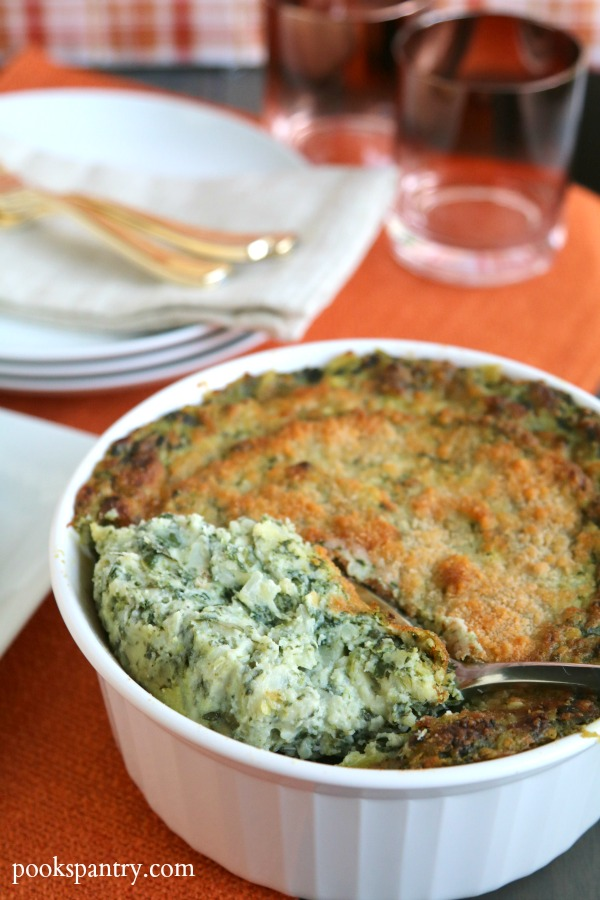 scoop of spinach potato casserole