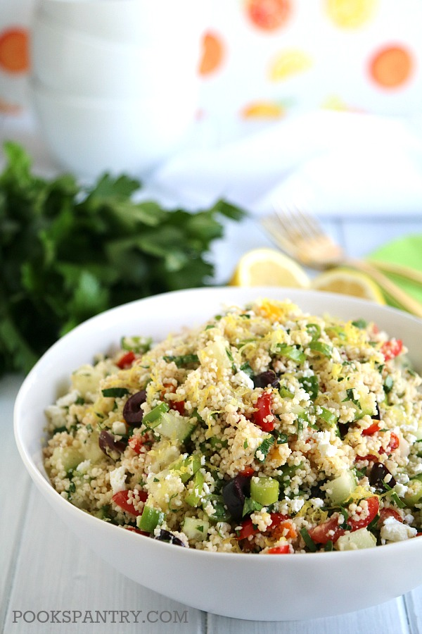 BOWL OF COUSCOUS WITH FETA, TOMATO, LEMON AND PARSLEY