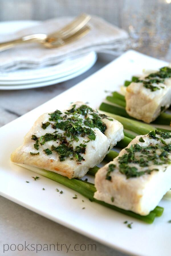 corvina with butter and herbs on white platter