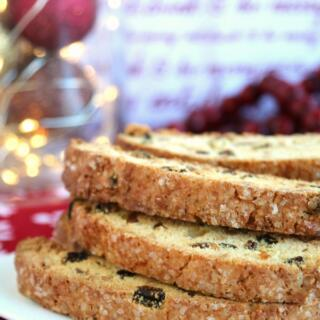 golden raisin biscotti with almonds on white plate