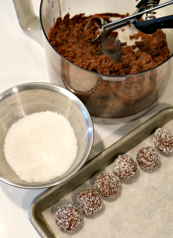 scooping out rum ball mixture