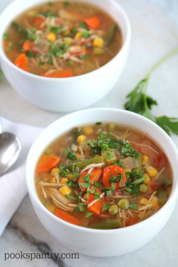 bowls of crockpot chicken vegetable soup