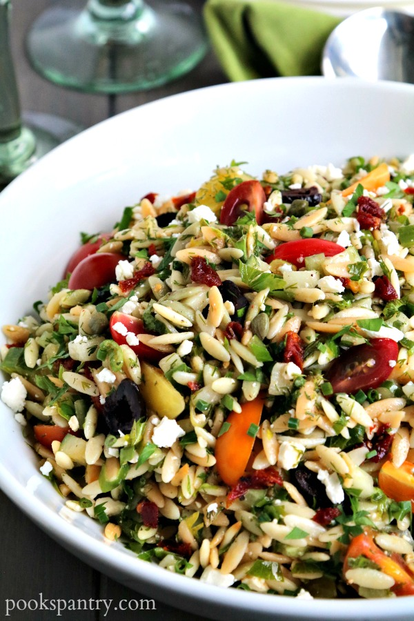 Mediterranean orzo salad in large white bowl