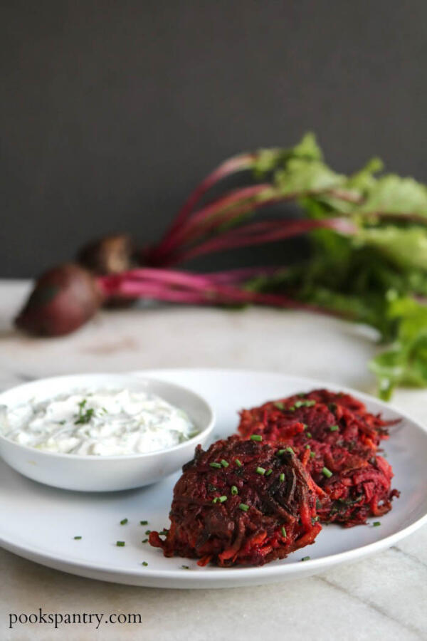 sweet potato and beetroot fritters on white plate